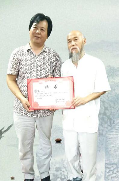 窦宝星与东方艺术天地项目总监冀新华董事长合影