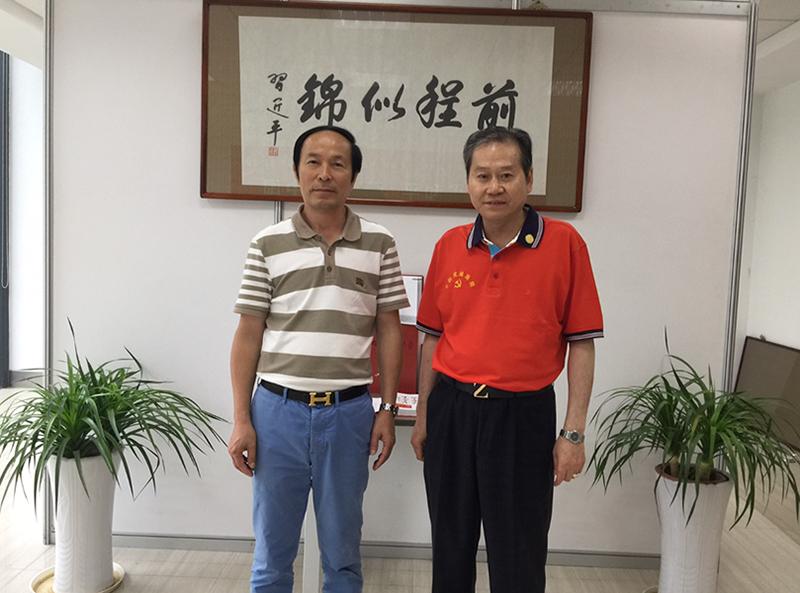 与联合国科教文促进会主席,中国党建画院院长张文祥合影