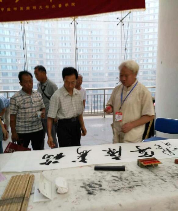 与朱锡实老师在济南会展中心切磋技艺